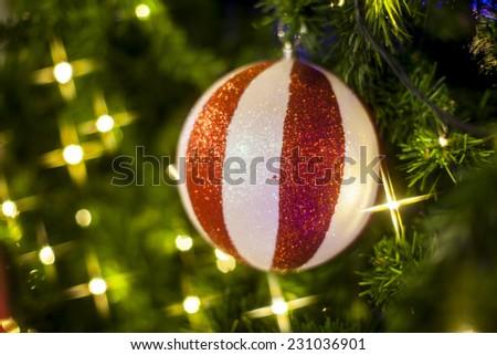Christmas Tree decorations lit background - stock photo