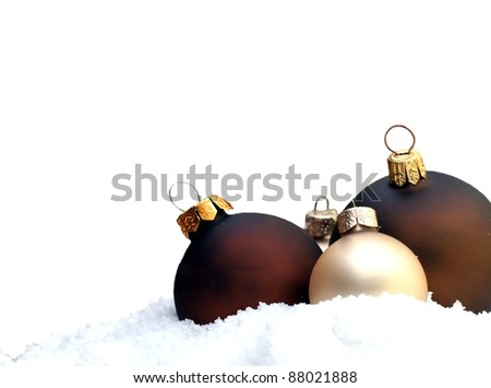 christmas tree decorations lying in the snow - stock photo