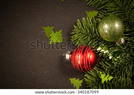 Christmas tree decorations on a black background - stock photo