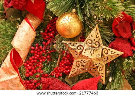 Christmas tree decorations with focus point on the golden star - stock photo