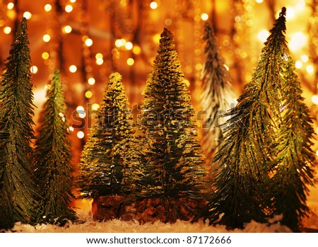 Christmas tree forest, holiday background with winter ornament & abstract blur bokeh lights decoration - stock photo