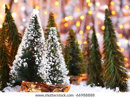 Christmas tree forest, holiday background with winter ornament & abstract defocus lights decoration - stock photo