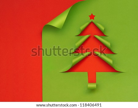Christmas tree formed from curled corner paper - stock photo
