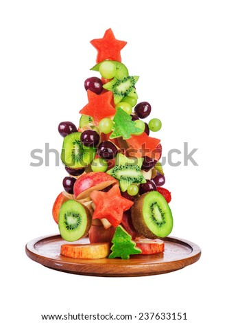 Christmas tree fruit salad with kiwi,cherry, grape and watermelon isolated on white - stock photo