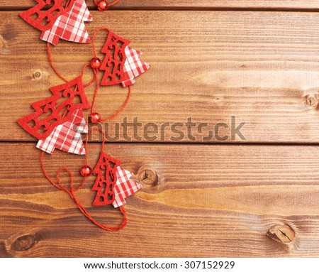 Christmas tree garland over the wooden surface as a festive background composition - stock photo