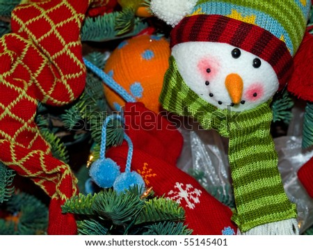 Christmas Tree Holiday Snowman Ornaments Hanging on a Tree - stock photo