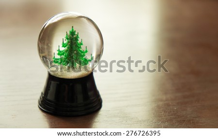 Christmas tree in a crystal ball  - stock photo