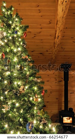 Christmas tree in cabin setting with wood stove burning.