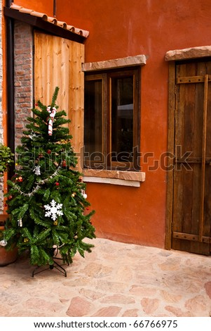 Christmas tree in front yard - stock photo