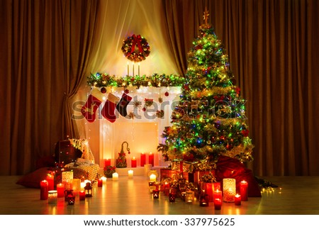Christmas Tree in Room, Xmas Home Night Interior, Fireplace Lights Decoration, Hanging Socks - stock photo