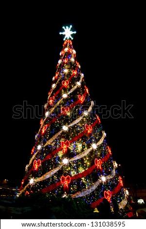 Christmas tree in the holiday illumination - stock photo