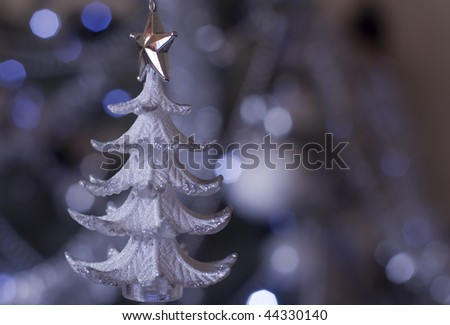 Christmas tree in the twinkling of lights - stock photo