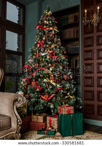 Christmas tree is decorated with toys - stock photo