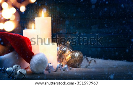 Christmas tree light; festive background with Christmas balls and Santa hats - stock photo