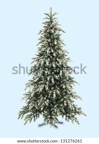 Christmas tree lit on background - stock photo