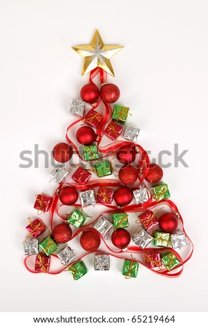 Christmas tree made from baubles, presents and ribbon on white background - stock photo