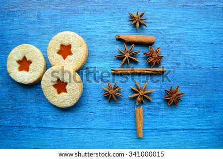 Christmas tree made from cinnamon and anise.Gingerbread cookies and Christmas toys - stock photo
