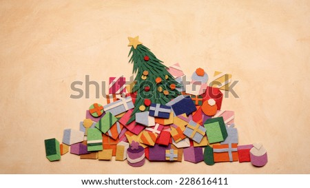 Christmas tree made from fabric - too many gifts concept - stock photo