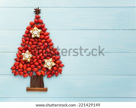 Christmas tree made of berries, cinnamon and anise. Viewed from above. - stock photo