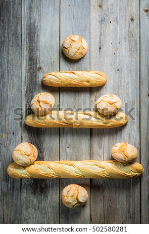 Christmas tree made of bread roll and baguette