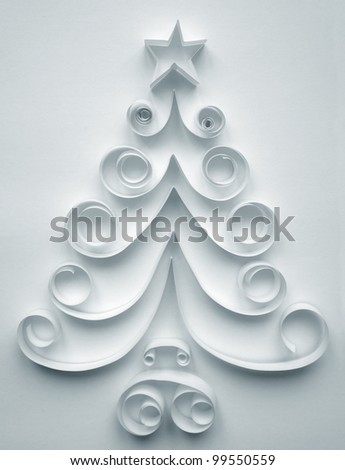 Christmas tree made of paper on white background - stock photo