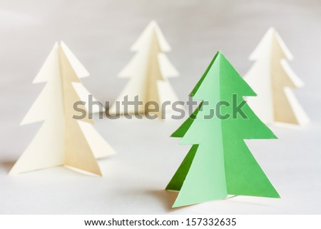Christmas Tree Made Of Paper. White And Unique Green Pine Trees. 2014, New Year - stock photo