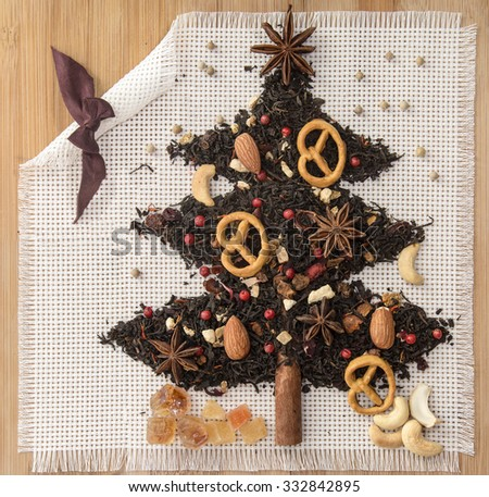 Christmas tree made of tea, coffee, pepper, cinnamon and anise, edible Christmas tree, symbol happy New Year,  viewed from above - stock photo