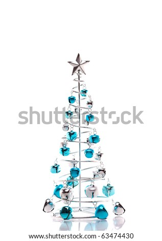Christmas tree made out of blue and silver jingle bells isolated on white - stock photo