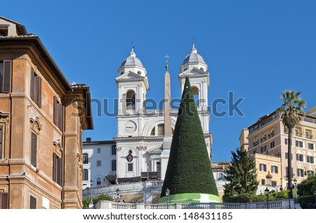 Christmas tree, obelisk and church on top of the spanish steps in Rome, Italy - stock photo