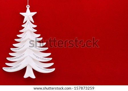 Christmas tree on a background of red velvet paper