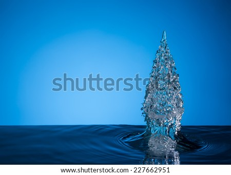 christmas tree on blue background - stock photo
