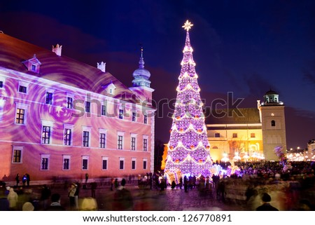 Christmas Tree on Castle Square at the Old Town of Warsaw in Poland, illuminated at night. - stock photo