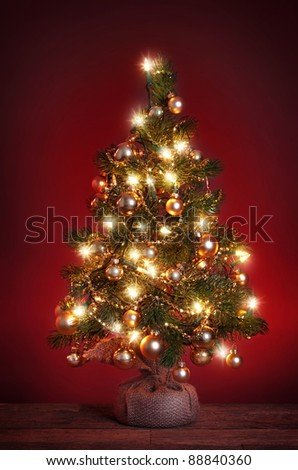 Christmas tree on red background - stock photo