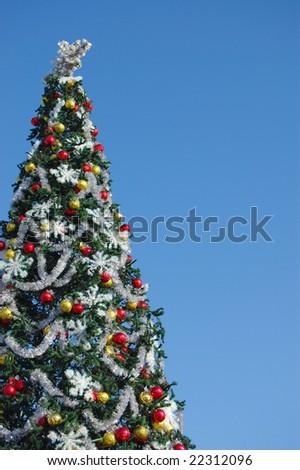 Christmas tree on sky background - stock photo