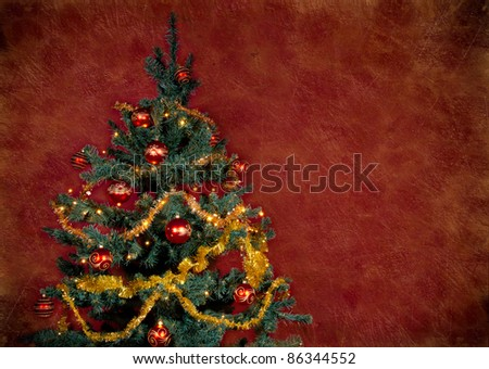 Christmas tree on vintage red background - stock photo