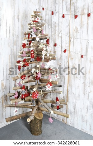 Christmas tree on wooden background. decorated Christmas tree holiday symbol. unusual Christmas tree design - stock photo
