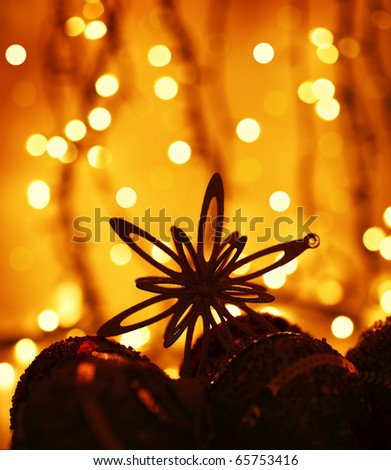Christmas tree ornament & decoration as a holiday background card over abstract defocus golden lights - stock photo