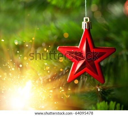 Christmas-tree ornament - red star with glare sparkles - stock photo