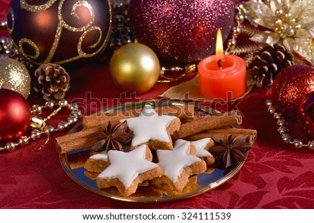Christmas tree ornaments and cookies with cinnamon sticks