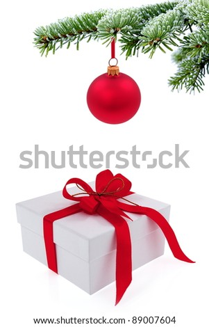 Christmas tree over  gift with red ribbon - stock photo