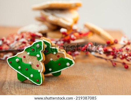 Christmas tree shaped cookies on wooden table - shallow DOF. - stock photo