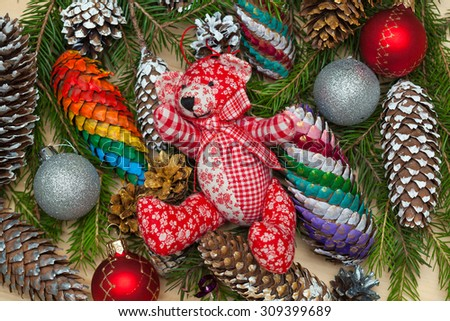 Christmas tree, toys and Christmas tree cones, teddy bear - stock photo