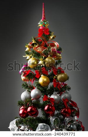 Christmas tree with a Christmas toys decoration  - stock photo