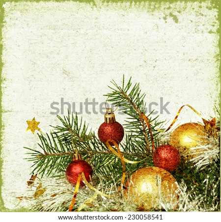 Christmas tree with balls and tinsel  on a green background