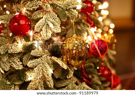 Christmas tree with beautiful and colorful ornaments - stock photo