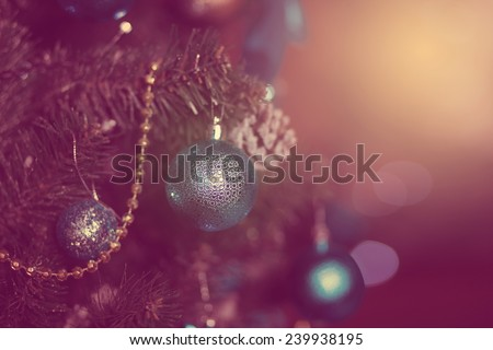 Christmas tree with beautiful blue balls and garlands, unusual magical toning, suitable for decoration greeting card - stock photo