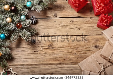 Christmas tree with Christmas decorations and Christmas present on a wooden surface. Christmas background. Top view. Copy space. Free space for text - stock photo