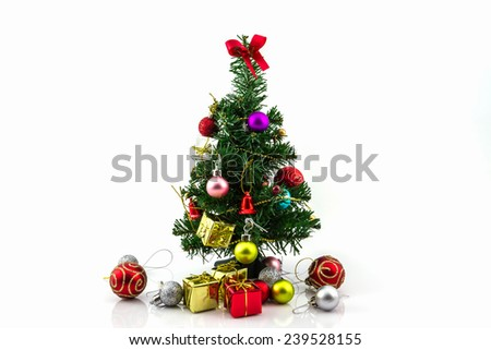 Christmas tree with colorful ornaments on white background.