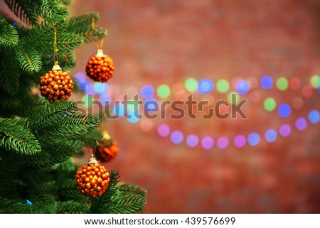 Christmas tree with decor on bright background, closeup - stock photo