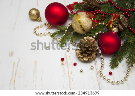 Christmas tree with decor on white wooden background